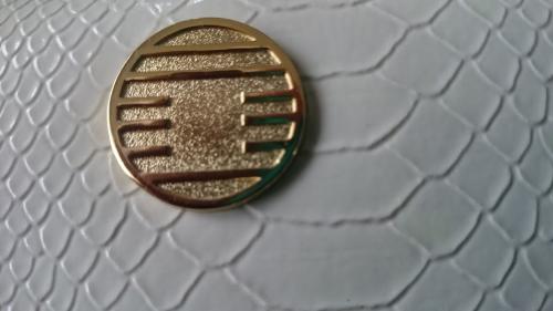 九星白蛇財布の中央のマークの意味と効果
